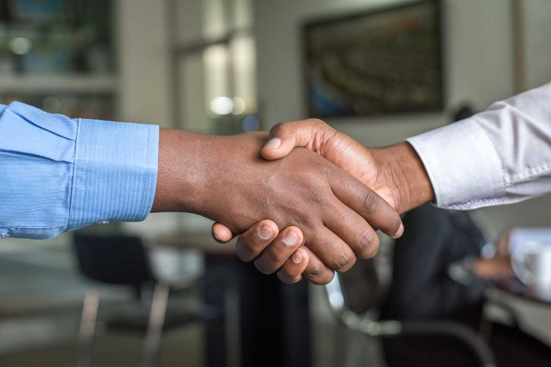 A handshake to indicate a good deal in succesful selling
